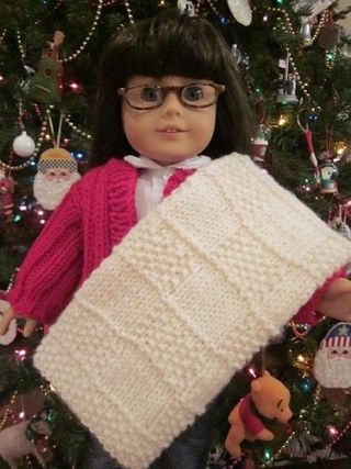 Here's my doll holding her new natural colored Checker Block Blanket
