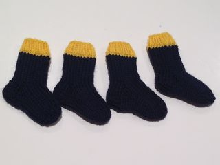 Four cub scout socks